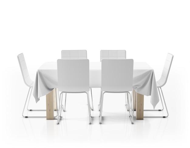 Mesa con mantel y sillas.