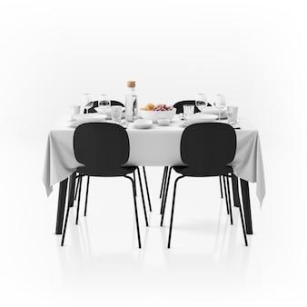 Mesa con mantel, vajilla y sillas.