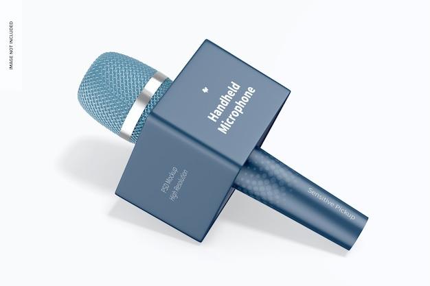 Micrófono de mano con maqueta de cubo, caído