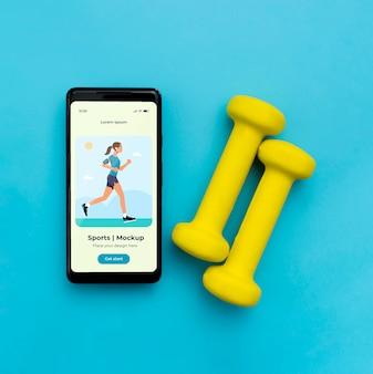 Mobiel en gewichten ernaast