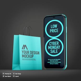 Mobiele mockup voor cyber monday geïsoleerd naast boodschappentas
