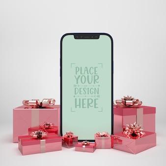 Mobiele telefoon omringd door cadeautjes