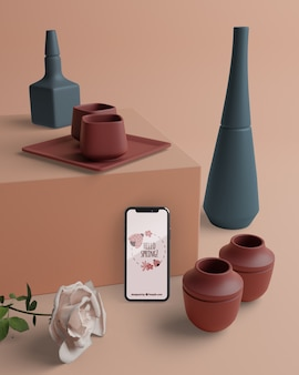 Mock-up 3d decoraties met telefoon op tafel