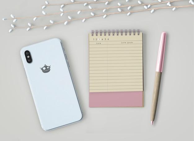 Mock up de cuaderno y teléfono móvil