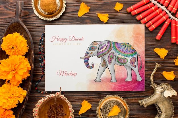 Mock-up felice di festival di diwali di vista superiore con l'elefante