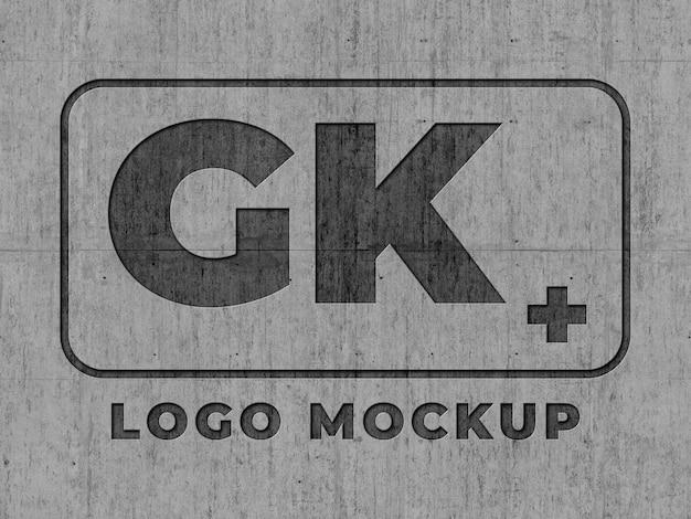 Mock-up logo superficie in cemento inciso