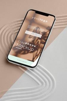Mock-up smartphone in zandsamenstelling