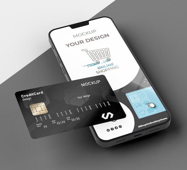 Mock up de tarjeta de crédito con móvil
