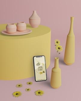 Mock-up vasi 3d con il telefono sul tavolo
