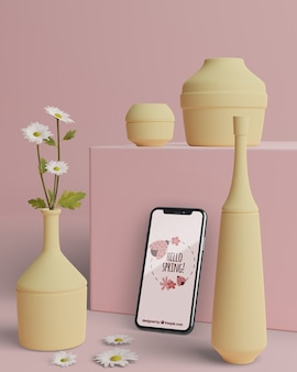 Mock-up vasi 3d per fiori con cellulare