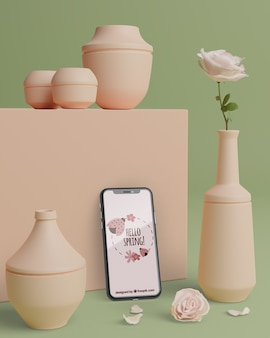 Mock-up vasi 3d per fiori con telefono