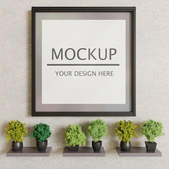 Mockup a telaio singolo su parete in gesso con piante decorative