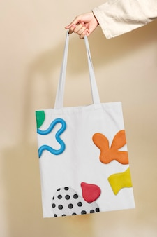 Mockup de bolso de lona psd con patrón abstracto de arcilla de plastilina