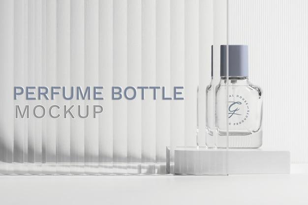 Mockup de botella de perfume psd con telón de fondo de producto de textura de vidrio estampado