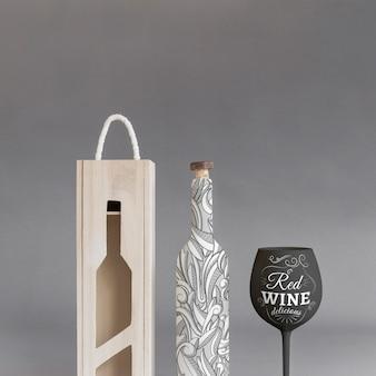 Mockup de botella de vino con caja y copa