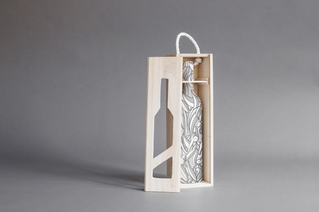Mockup de botella de vino en caja de madera