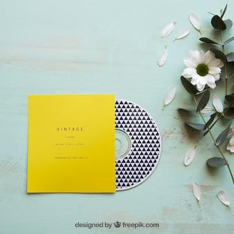 Mockup de cd y flor