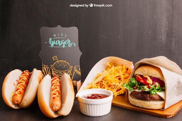 Mockup de comida rápida con dos perritos y hamburguesa