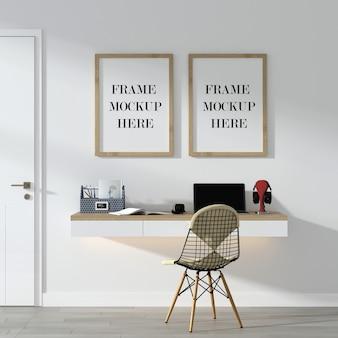 Mockup con cornice a doppia parete sopra la scrivania a parete
