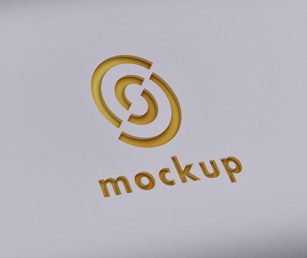 Mockup con logo intagliato in oro
