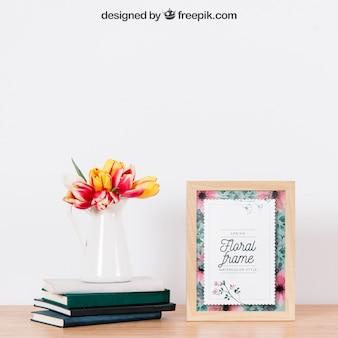 Mockup de marco al lado de planta en libros