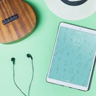Mockup de música con auriculares y tablet