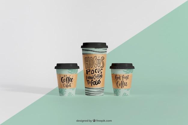 Mockup decorativo de tres vasos de café