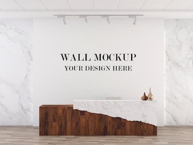 Mockup della parete della reception in combinazione di marmo e legno