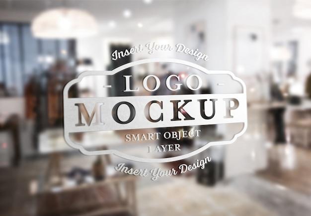 Mockup design del logo segnaletica trasparente finestra