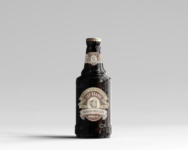 Mockup di bottiglia di birra vetro ambrato con gocce d'acqua - vista frontale