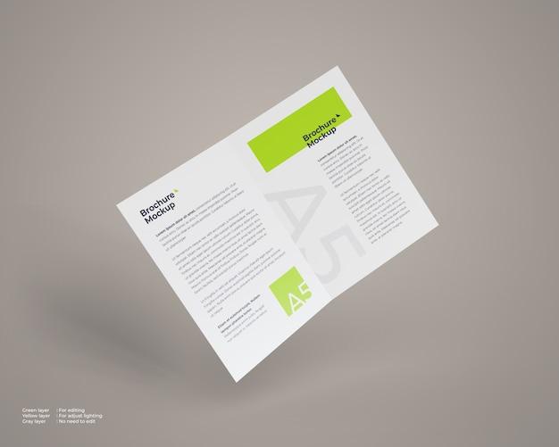 Mockup di brochure pieghevole a5 in volo