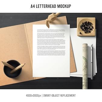 Mockup di carta intestata a4 con il concetto di spazio di lavoro