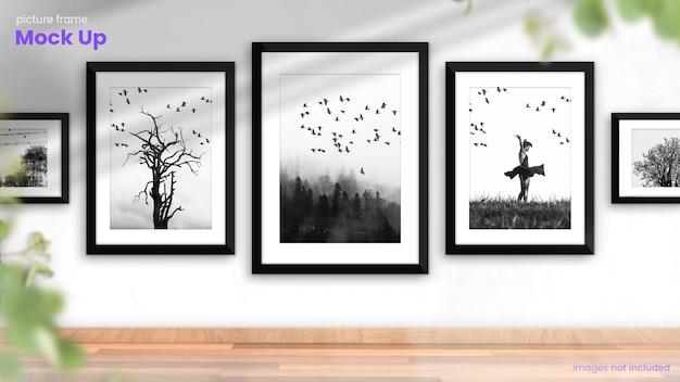 Mockup di cornice per foto di una raccolta di cornici per foto in interni luminosi e moderni