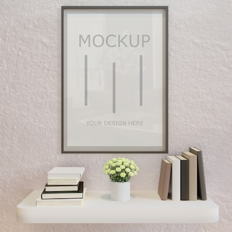 Mockup di cornice poster orizzontale sul muro bianco con mensola a libro