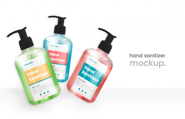 Mockup di disinfettante per le mani moderno di tre flaconi volanti con pompa a gel per alcool