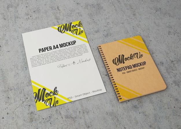 Mockup di foglio di carta e notebook