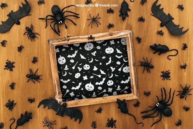 Mockup di halloween con ardesia e pipistrelli
