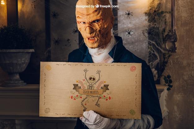 Mockup di halloween con cartone mostro azienda