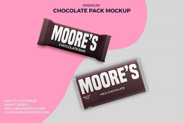 Mockup di imballaggi in carta e fogli di barretta di cioccolato