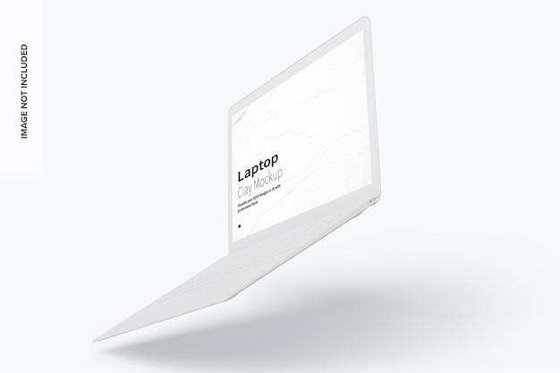 Mockup di laptop di argilla che galleggia a destra vista
