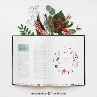 Mockup di libro aperto con foglie