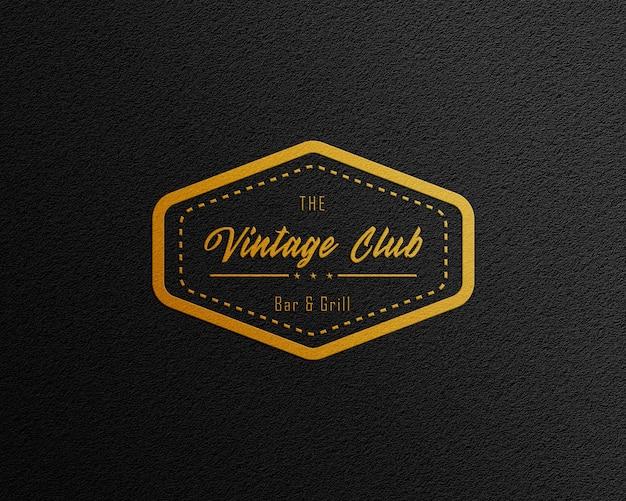 Mockup di logo in carta nera con lamina d'oro
