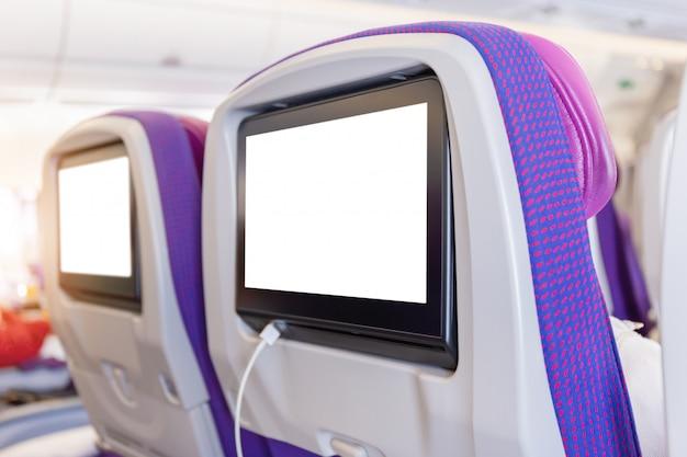Mockup di monitor di aerei sulla cabina nell'interno dell'aereo del sedile passeggeri
