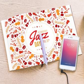Mockup di musica con smartphone e brochure