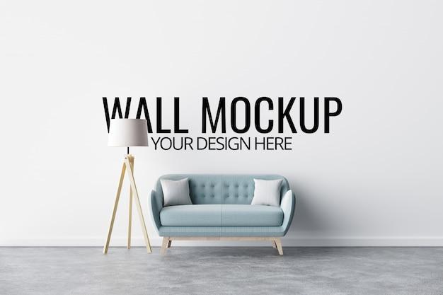 Mockup di parete in interni bianchi con divano e decorazione