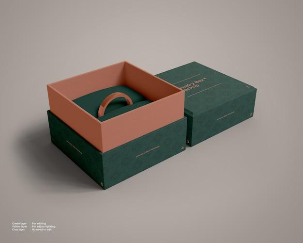 Mockup di scatola di gioielli aperto con un anello all'interno