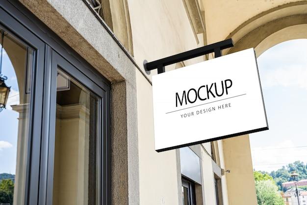 Mockup di segno bianco azienda quadrata per logo