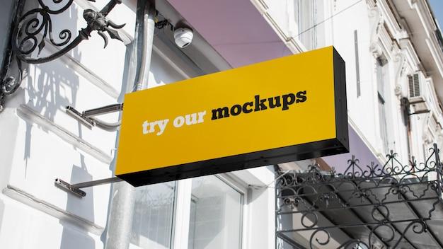 Mockup di segno logo negozio rettangolare