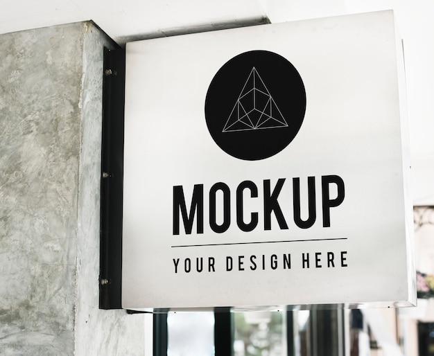 Mockup di segno negozio minimale con disegno geometrico