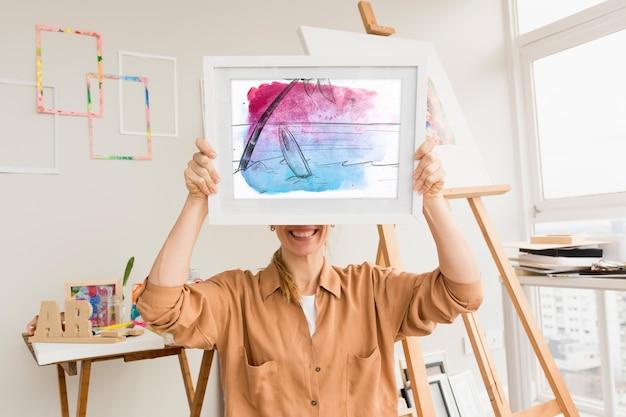 Mockup di telaio con il concetto di arte dello studio